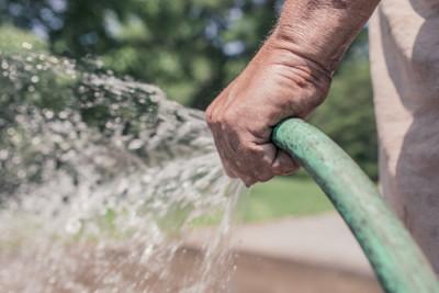 Water Hose 400x267 Run Off Redux: Reusing Rainwater in the Garden